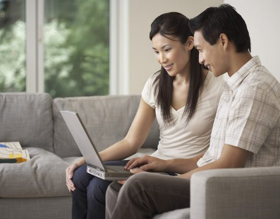 Couple on Sofa Using a Laptop